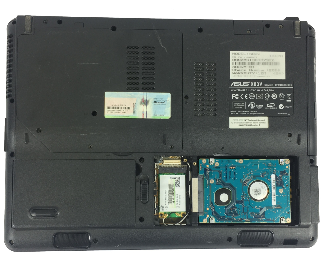 Asus laptop back cover opened exposing hard disk drive
