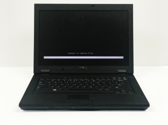 "Dell 14 inch laptop in black has black screen with white line on the bottom which says ""windows is loading files..."""