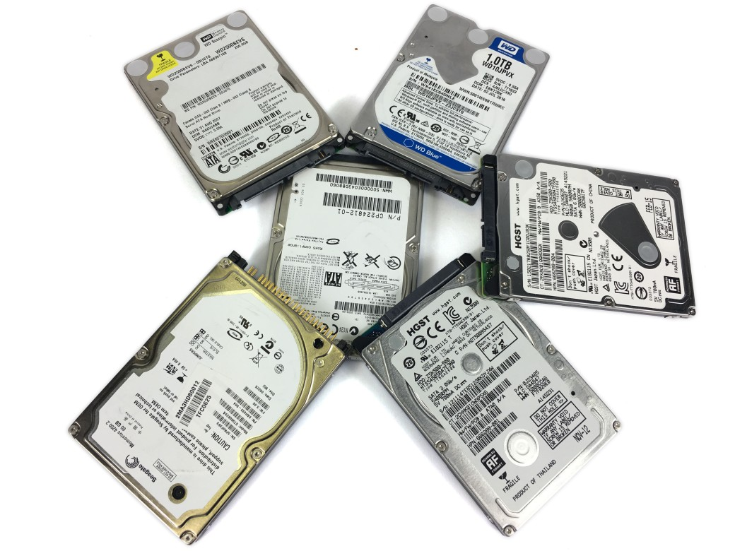 Hard Disk Drives Piled up together for replacement