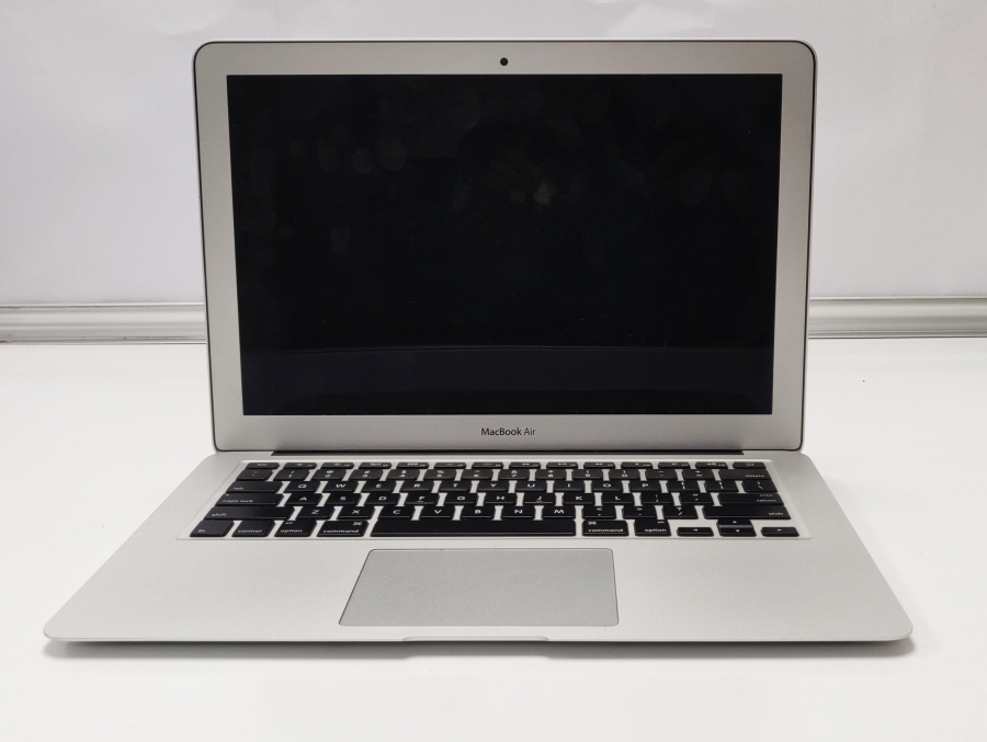 Macbook Air Silver on a white background standing upright at 90 degree