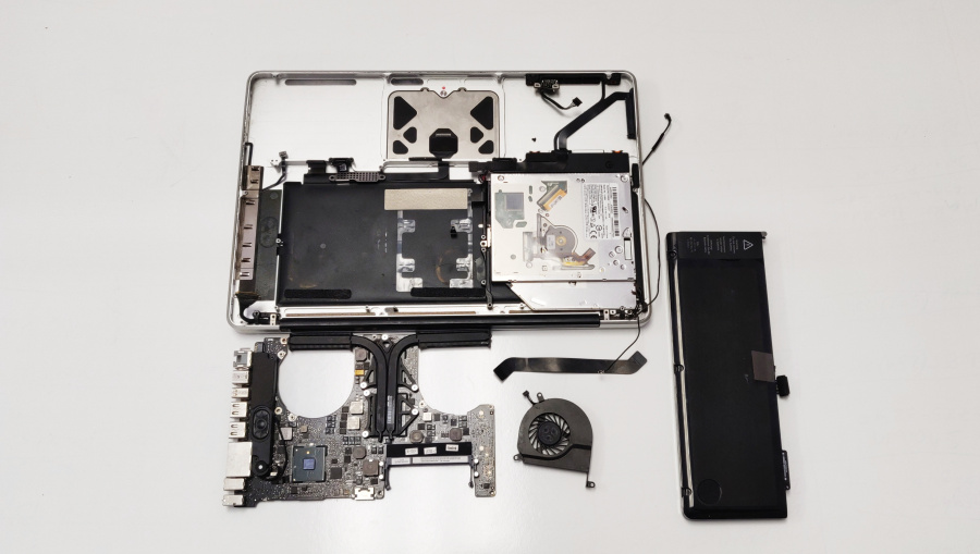 Macbook Pro complete teardown with fan battery and motherboard on the table